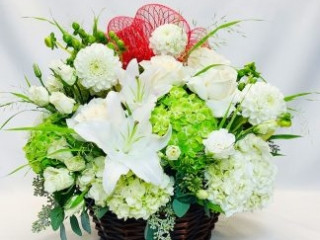 hydrangeas, shamrock hydrangeas, lilies, roses, dahlias, spray roses and accent greens.