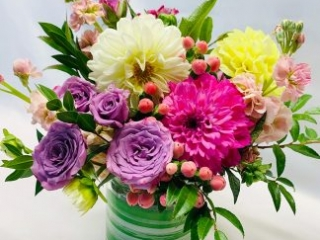 purple spray roses, dahlias, stocks and accent fillers