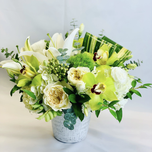 garden roses, cymbidium orchids, lilies, hydrangeas, and filler greens